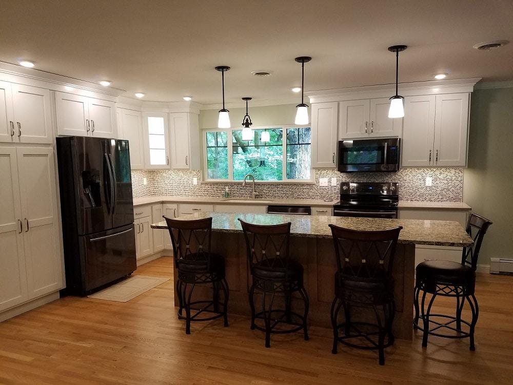 Corridor kitchens north liberty cabinetry design for Corridor kitchen designs